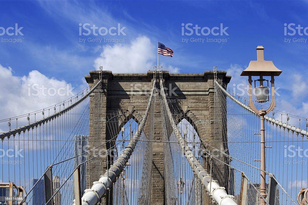 Brooklyn Bridge and American flag royalty-free stock photo