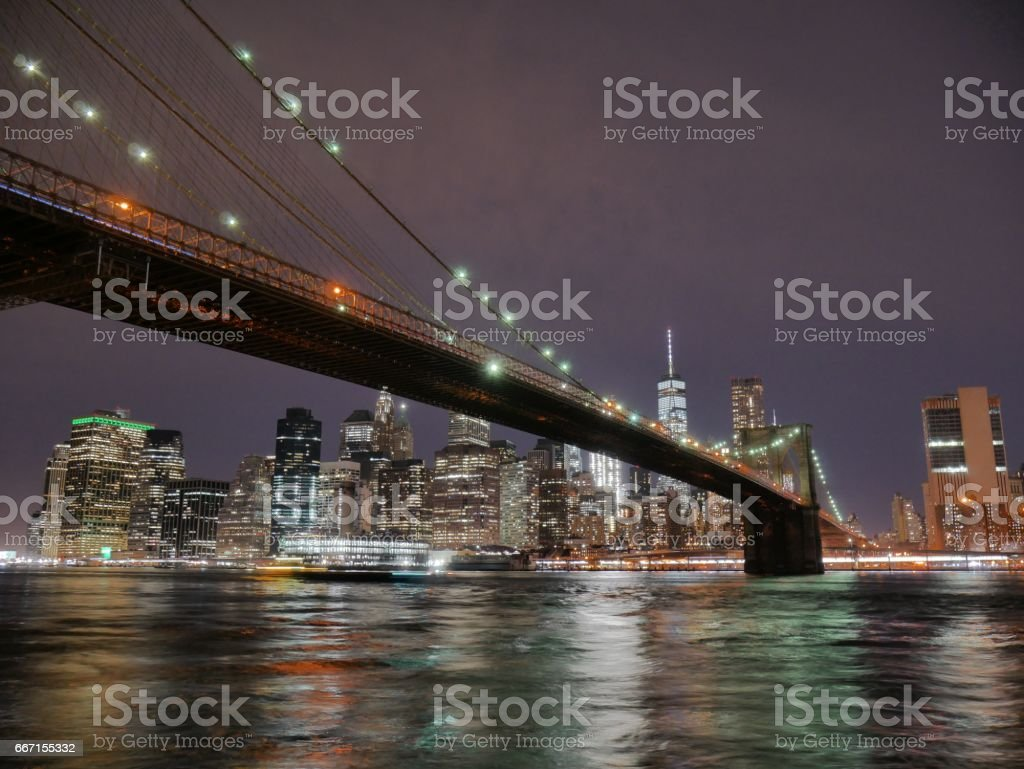 Brooklyn bridge and lower Manhattan skyline at night view from DUMBO stock photo
