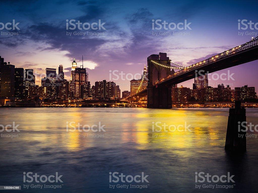 Brooklyn Bridge and Manhattan New York City Skyline at Night royalty-free stock photo