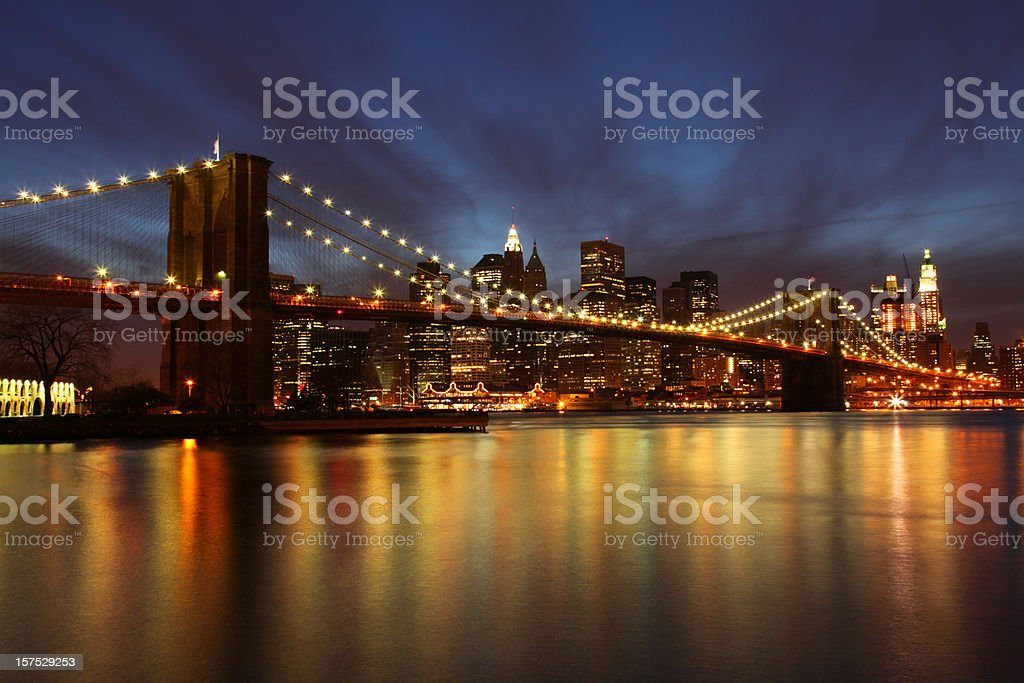 Brooklyn Bridge and Manhattan skyline at dusk, New York City royalty-free stock photo