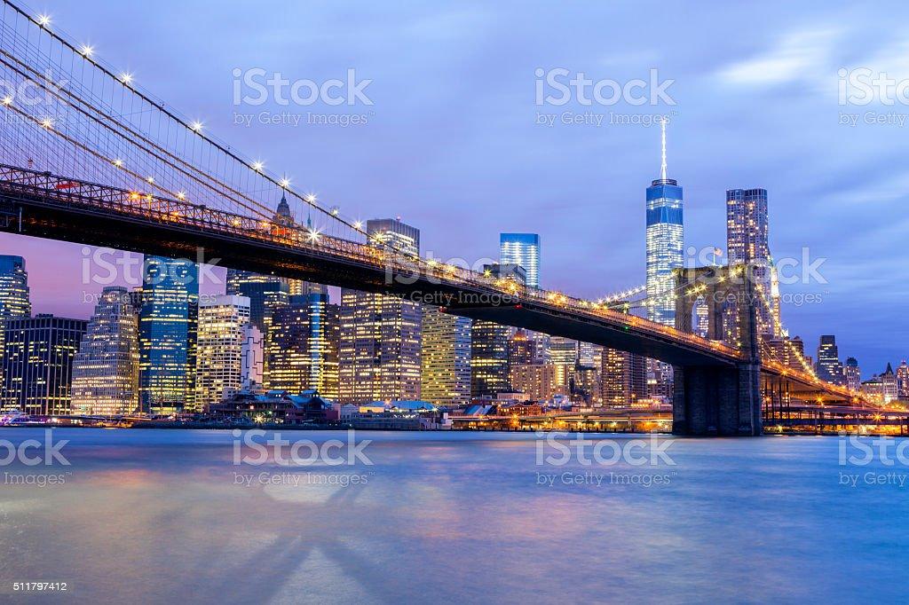 Brooklyn Bridge and Manhattan Skyline Illuminated at Dusk, New York stock photo
