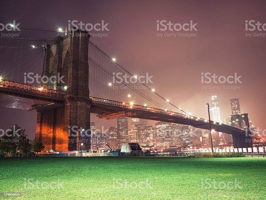 Brooklyn bridge and New York City skyline by night royalty-free stock photo
