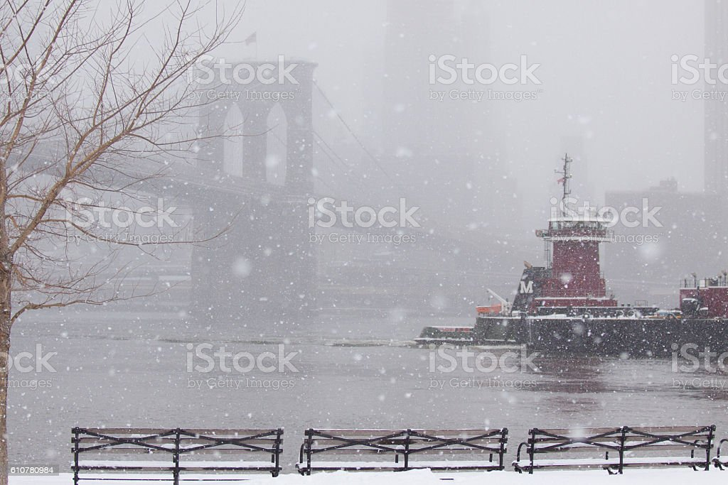 Brooklyn Bridge and tugboat stock photo