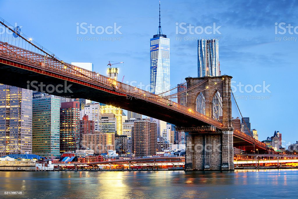 Brooklyn bridge and WTC Freedom tower at night, New York stock photo