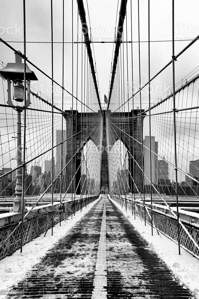 Brooklyn bridge covered with snow royalty-free stock photo