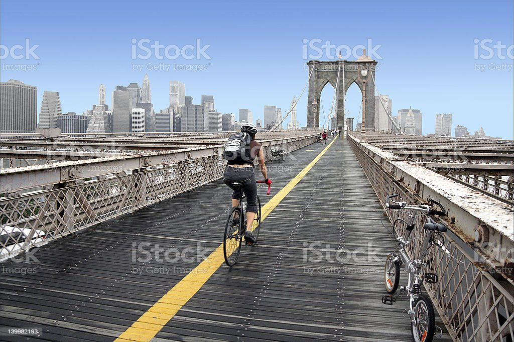 Brooklyn Bridge cyclist stock photo
