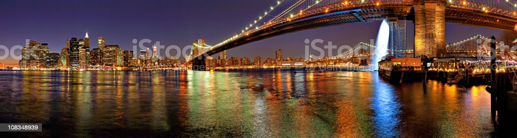 brooklyn bridge, east river and manhattan by night royalty-free stock photo