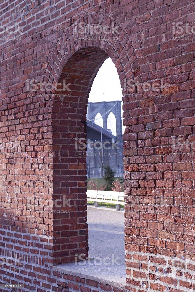 Brooklyn Bridge framed through brick window royalty-free stock photo