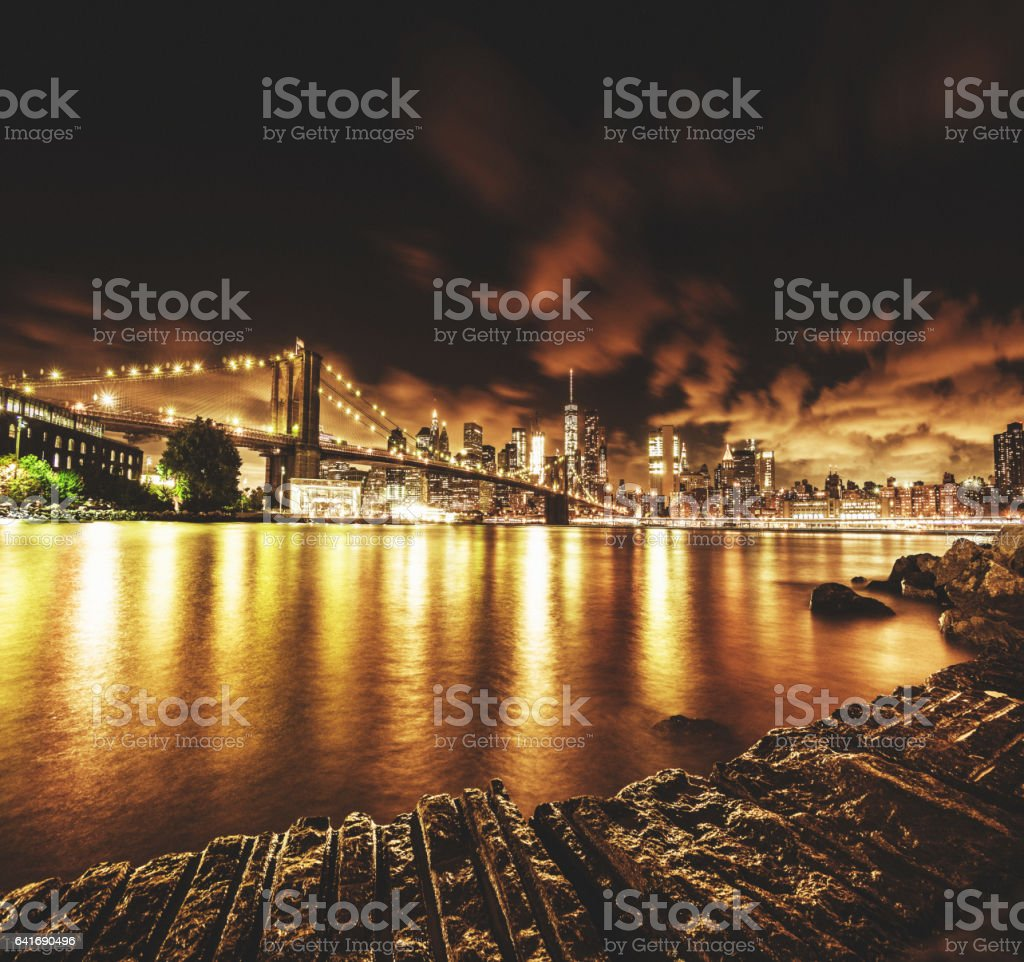 brooklyn bridge in new york at night stock photo