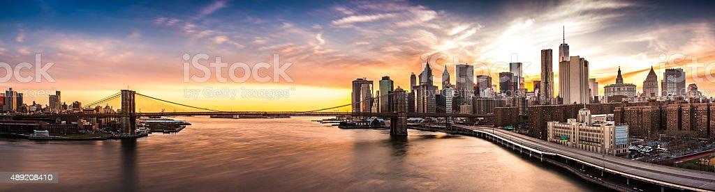 Brooklyn Bridge panorama at sunset stock photo