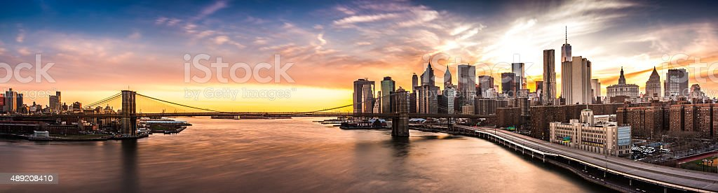 Brooklyn Bridge panorama at sunset stock photo