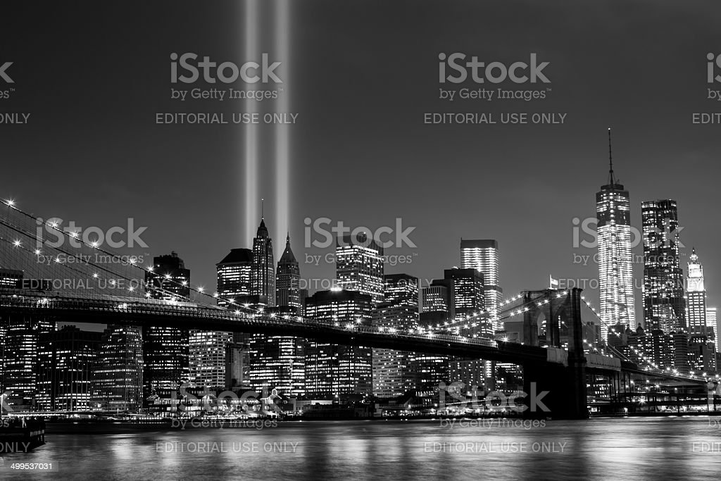 Brooklyn Bridge with Manhattan skyline and The Tribute in Light stock photo