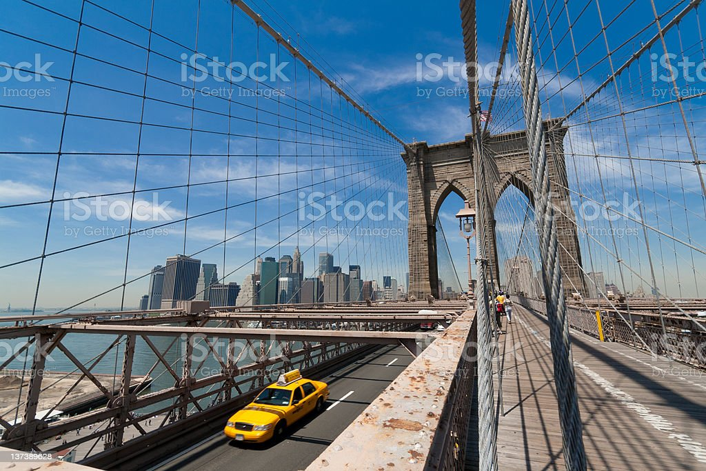 Brooklyn bridge with taxi driving royalty-free stock photo