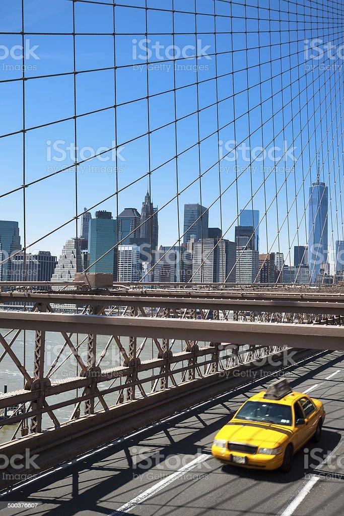 Brooklyn Bridge, Yellow Taxi Cab, Manhattan Skyline royalty-free stock photo