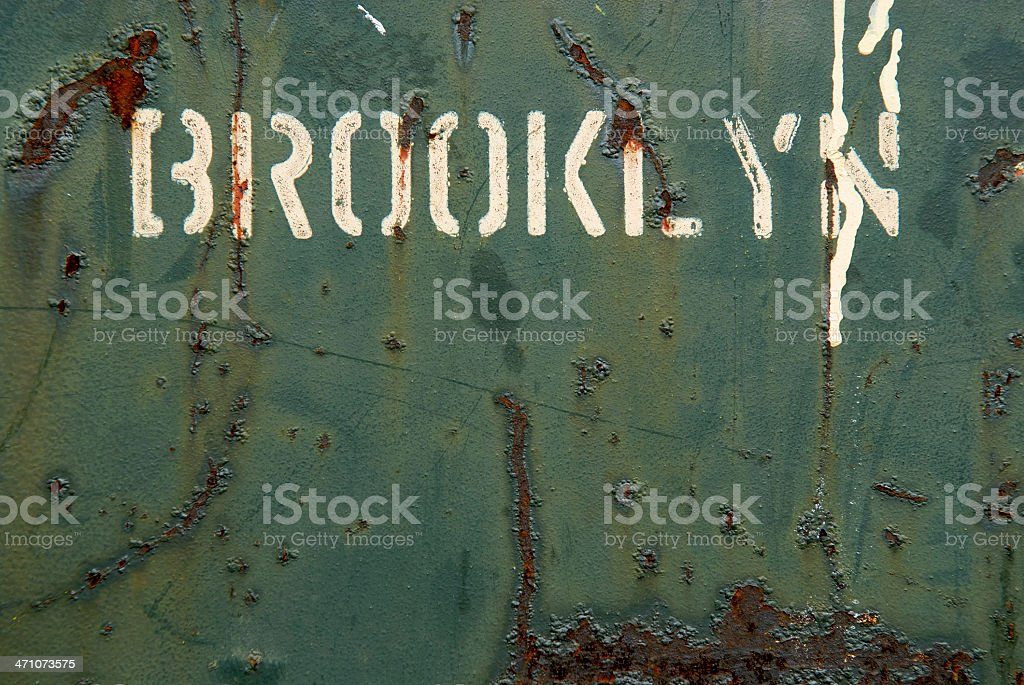 Brooklyn painted onto a green, rusty metal surface stock photo