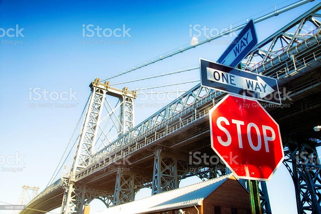 Brooklyn Williamsburg bridge with stop one way sign stock photo