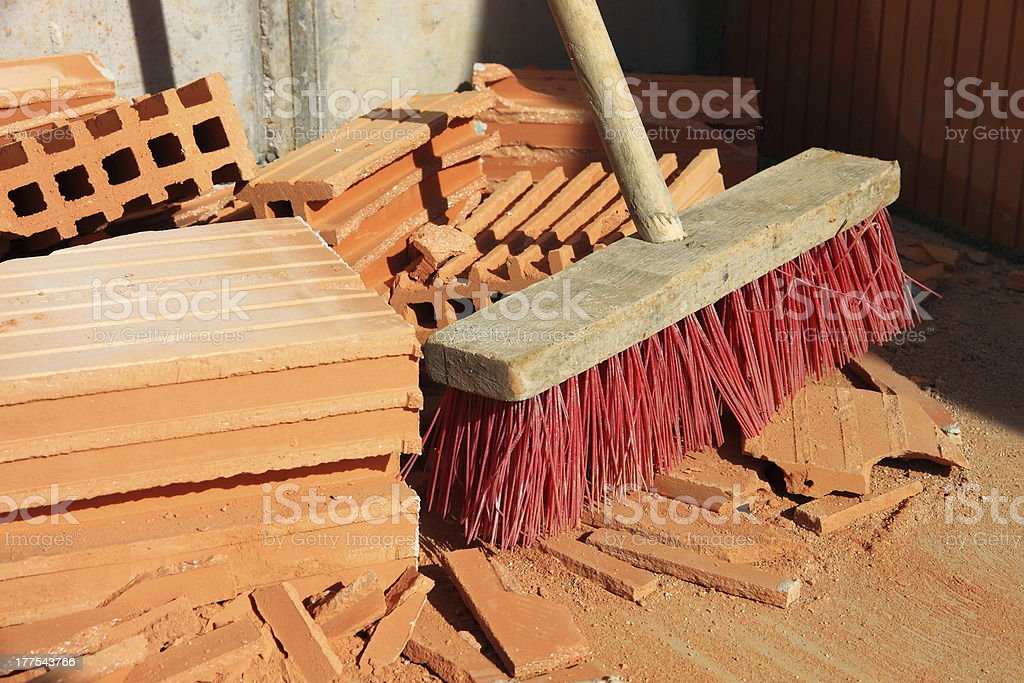 Broom and bricks on a construction site stock photo
