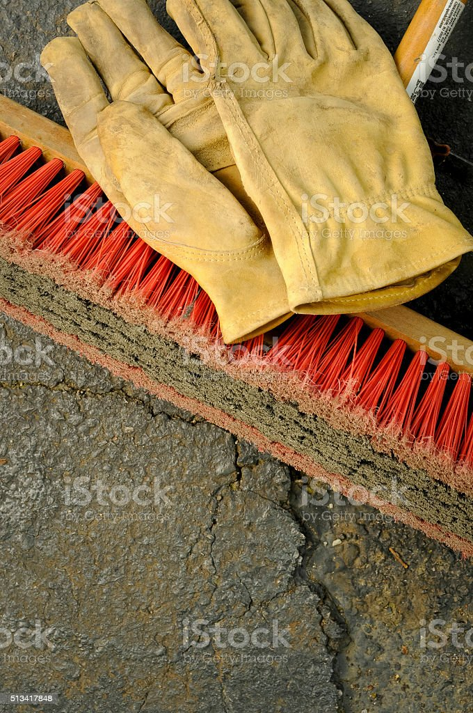 Broom and Gloves stock photo