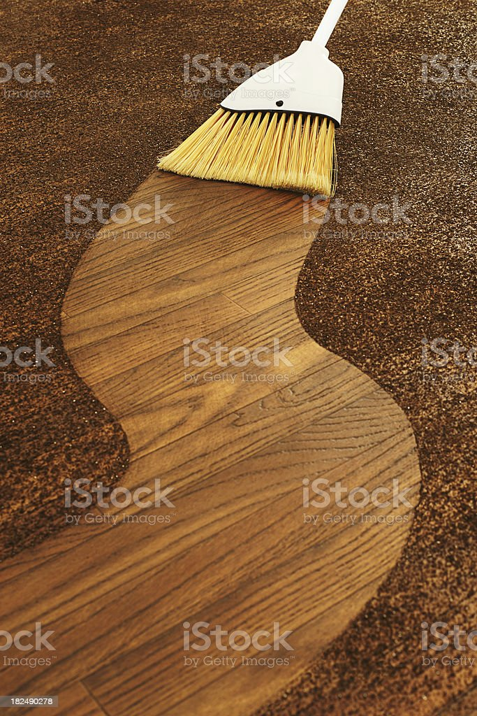 Broom Sweeping a Path Through Dirt stock photo