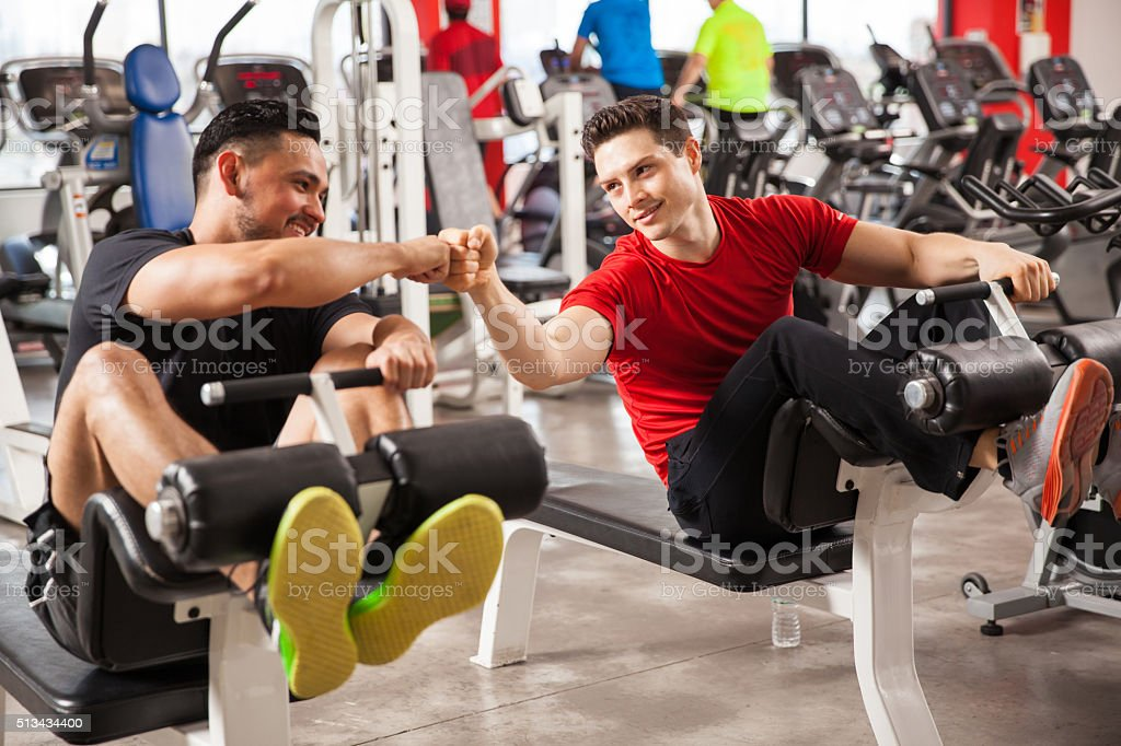 Bros working out together in a gym stock photo