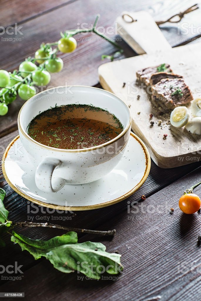 broth with egg stock photo