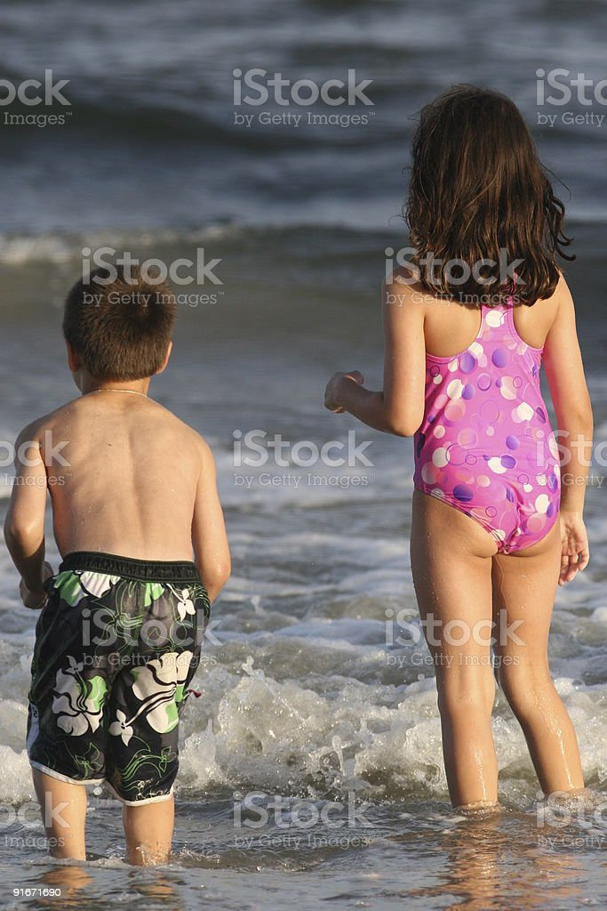 Brother and sister at beach royalty-free stock photo