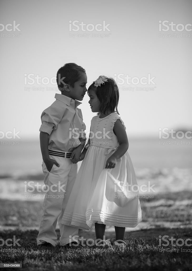 Brother and Sister by the sea stock photo