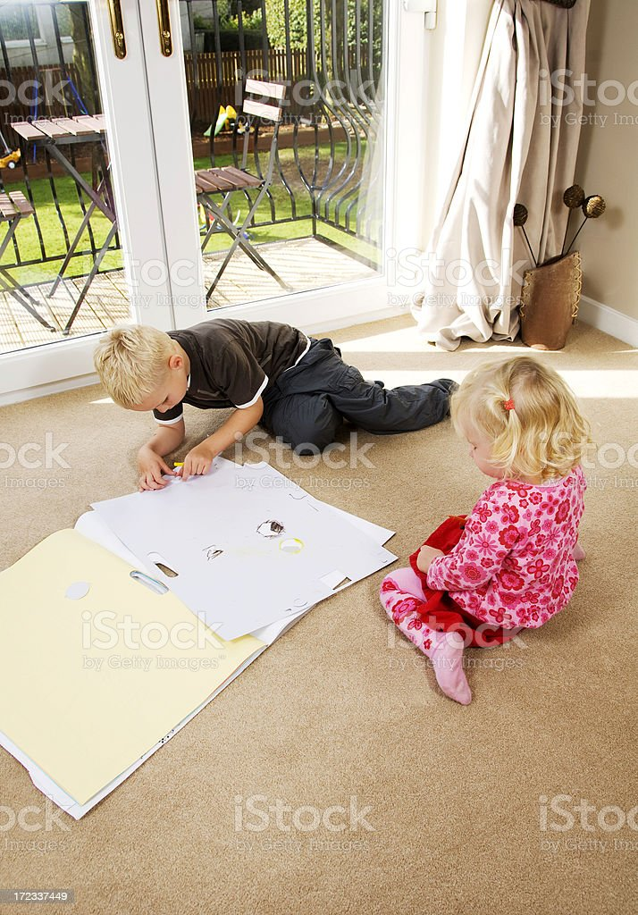 brother and sister drawing at home royalty-free stock photo