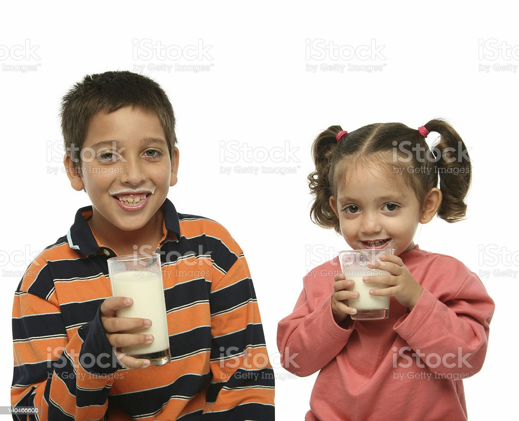 Brother and sister drinking milk stock photo