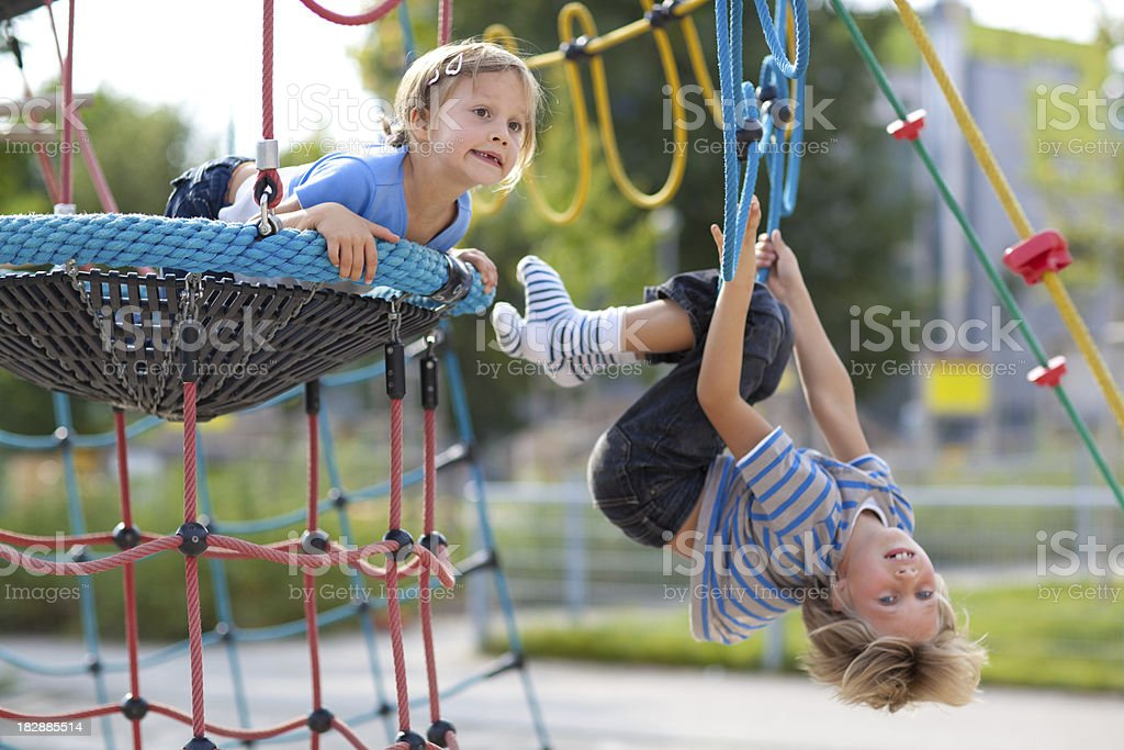 brother and sister enjoying day on playground royalty-free stock photo