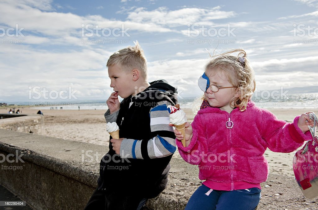 brother and sister enjoying ice cream royalty-free stock photo