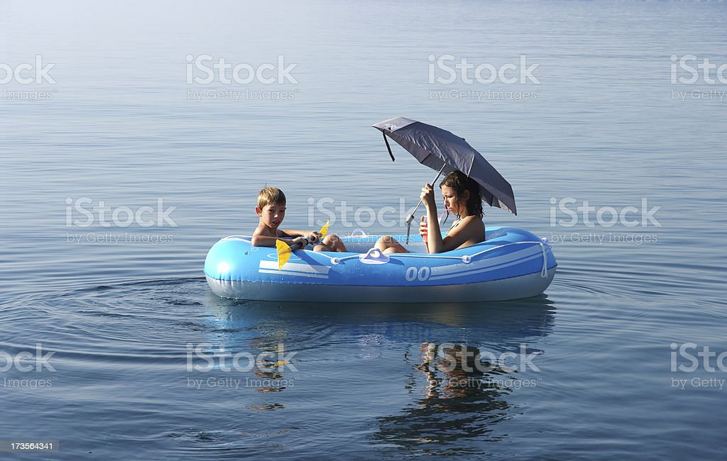 Brother and sister enjoying on boat stock photo