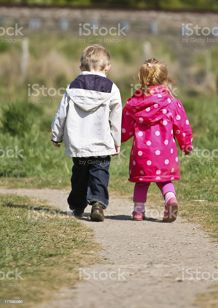 Brother and Sister enjoying the walk stock photo