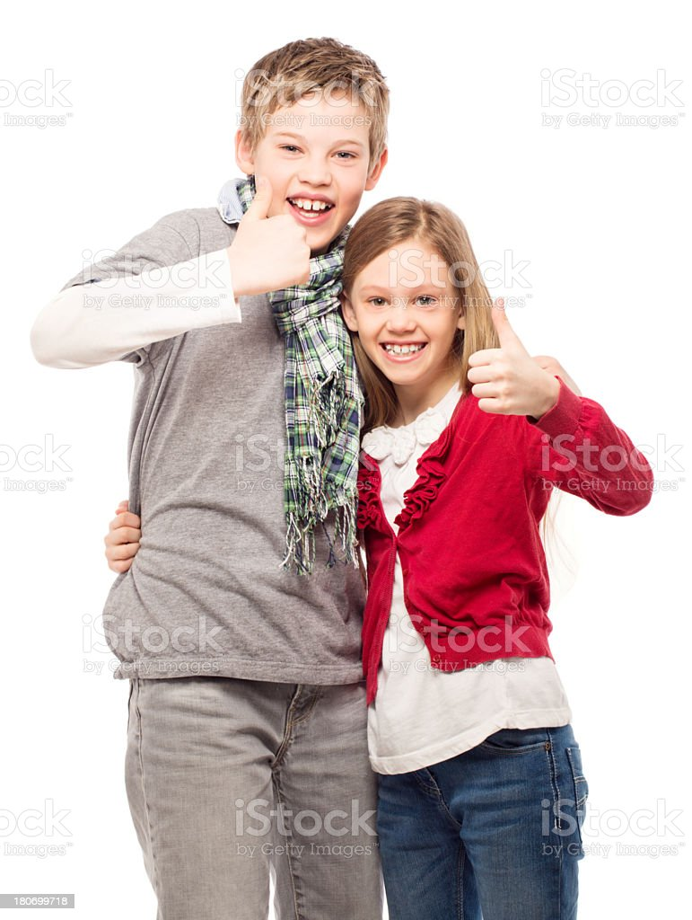 Brother and sister giving thumbs up royalty-free stock photo