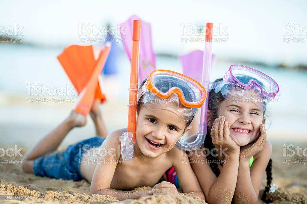 Brother and Sister Happily at the Beach stock photo