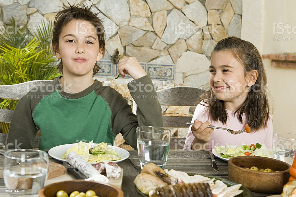 Brother and sister having meal royalty-free stock photo