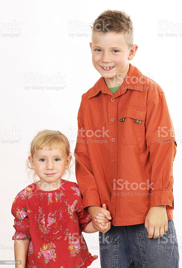 Brother and sister holding hands royalty-free stock photo