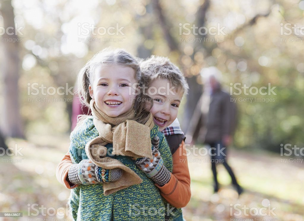 Brother and sister hugging outdoors royalty-free stock photo