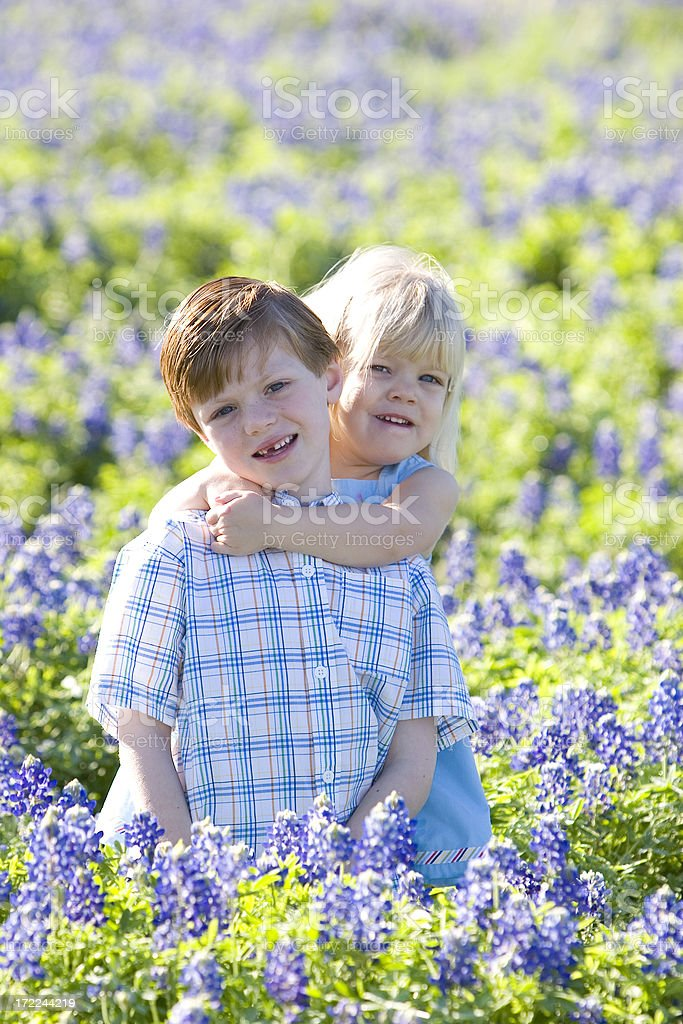 Brother and Sister in Bluebonnets royalty-free stock photo