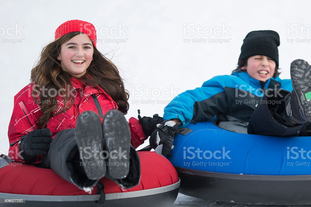 Brother and Sister Inner Tubing stock photo
