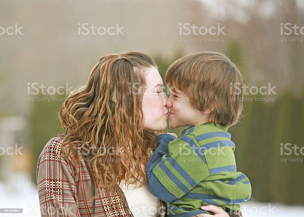 Brother and Sister Kissing royalty-free stock photo