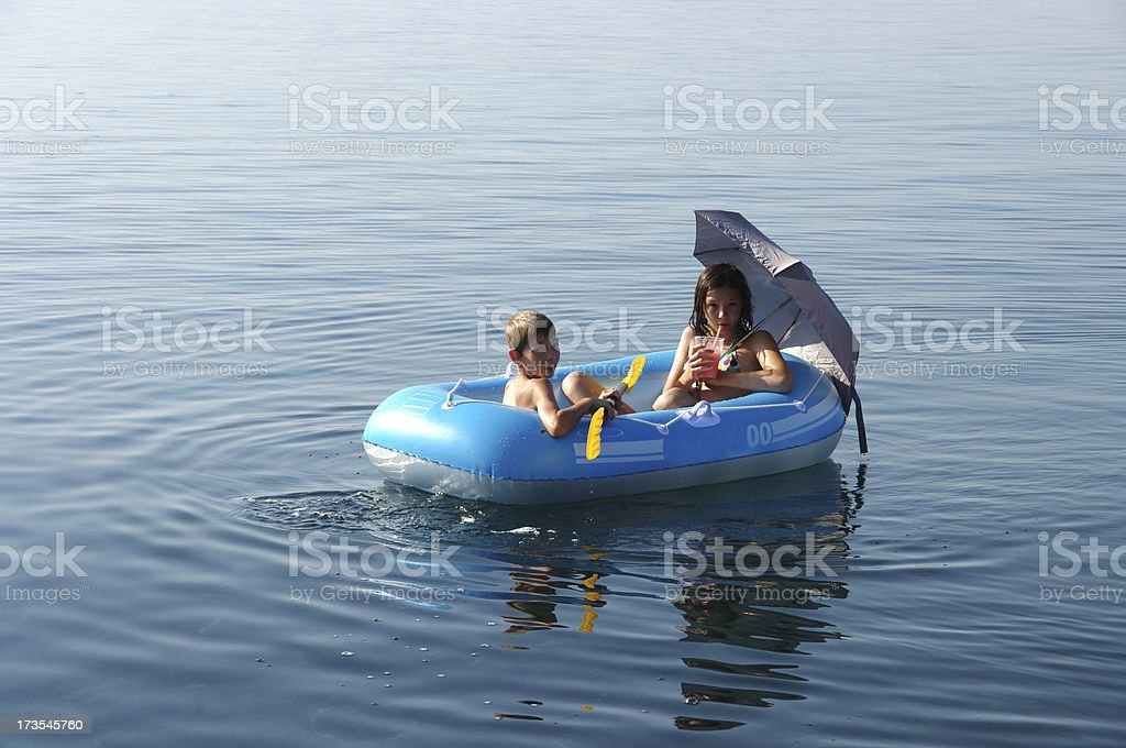 Brother and sister on boat royalty-free stock photo