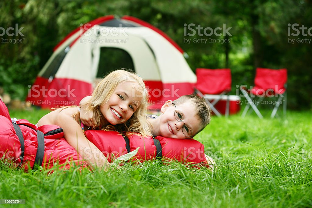 Brother and sister on camping site royalty-free stock photo