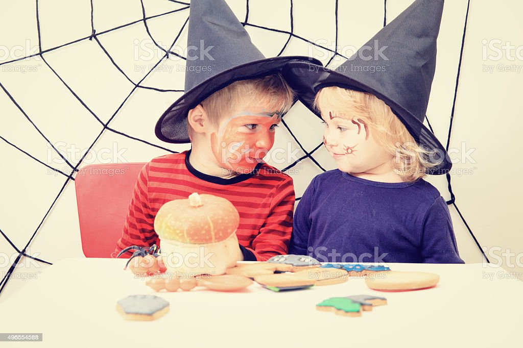 brother and sister on Halloween party stock photo