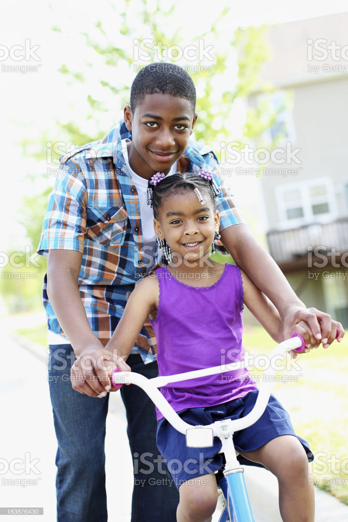 Brother and sister on the bike royalty-free stock photo