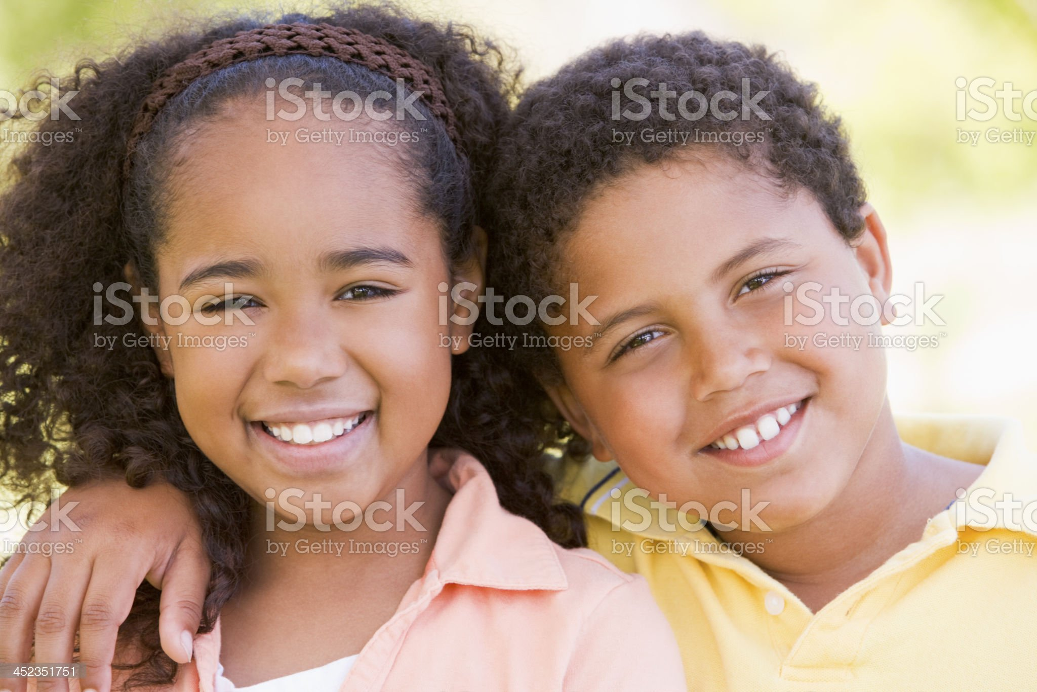 Brother and sister outdoors smiling royalty-free stock photo