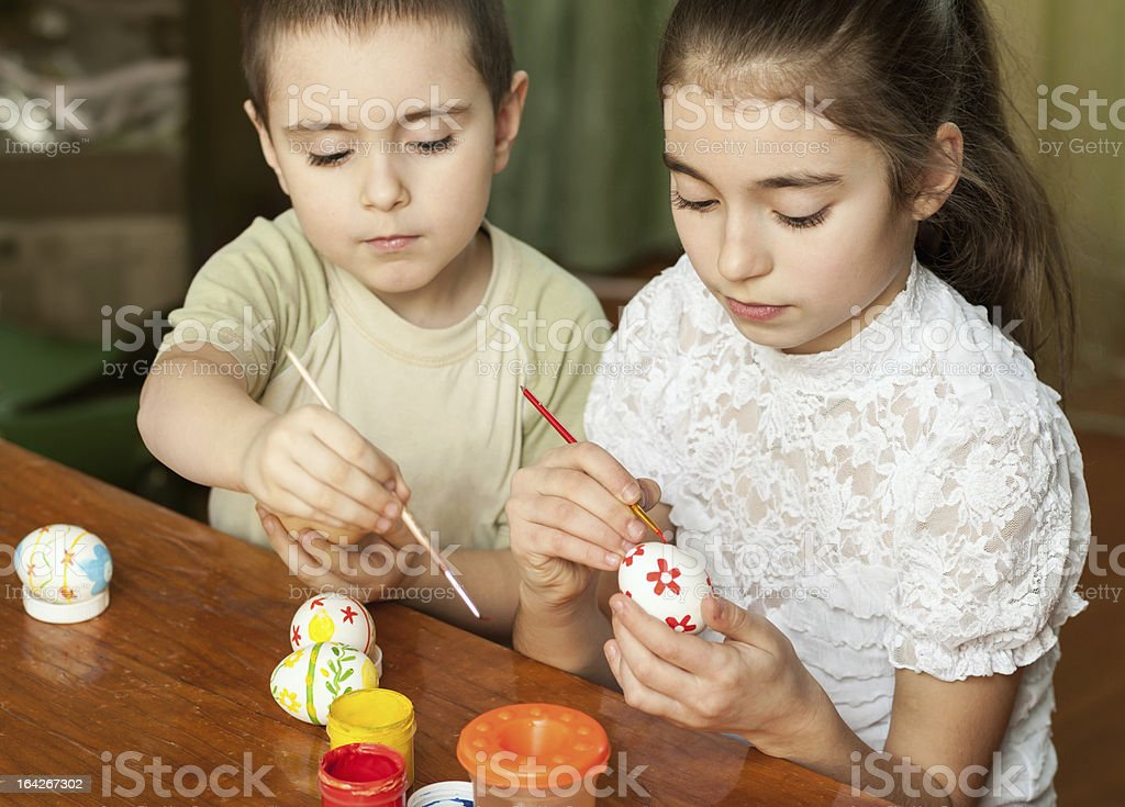 brother and sister painted Easter eggs royalty-free stock photo