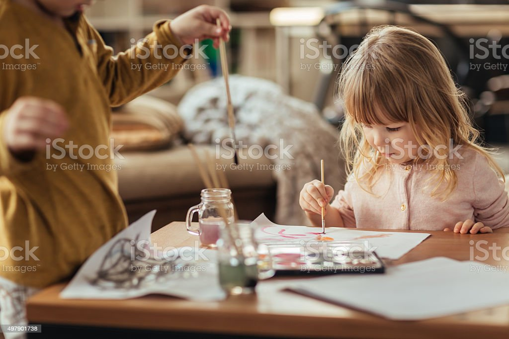 Brother and sister painting stock photo