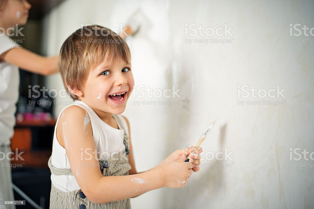 Brother and sister painting room white stock photo
