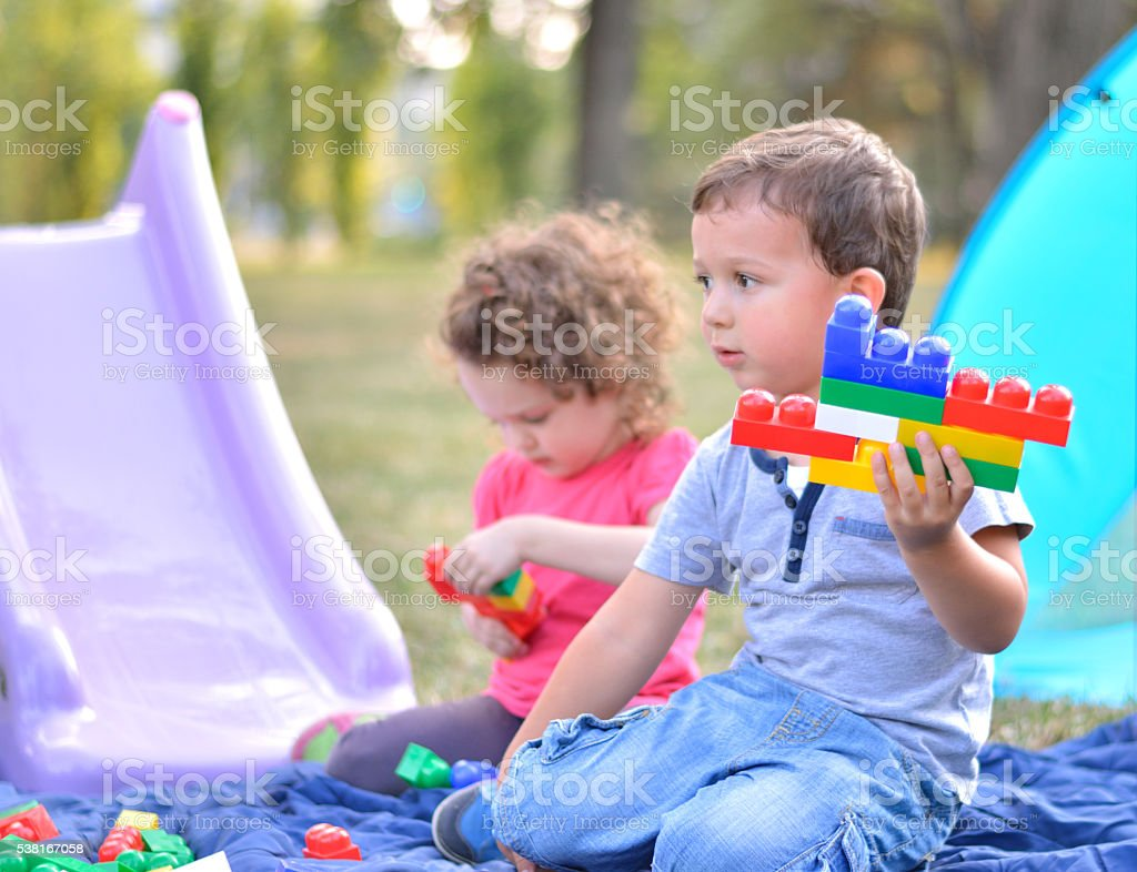 Brother and Sister Playing at Park stock photo